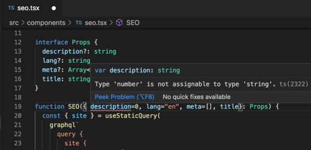 A build-time error in VSCode when the description variable is set to a number.