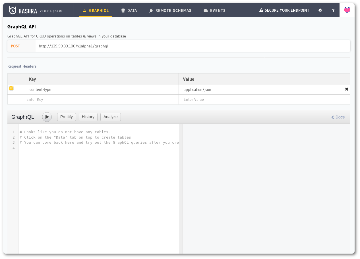 A screenshot of the Hasura console showing the default GraphiQL tab where users can try out GraphQL queries.
